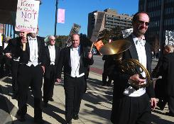 French horn player Karl Pituch pickets in formal attire with other Detroit symphony members in front of the Max Fisher Music Center in October.